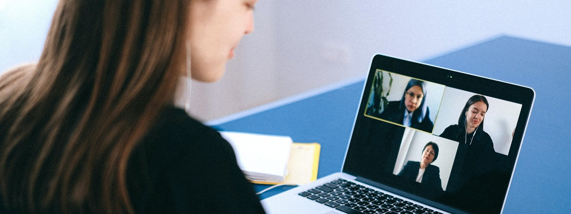 woman in remote meeting on a laptop